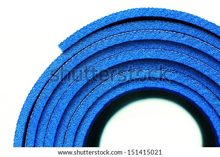 A part of rolled up yoga mat - stock photo
