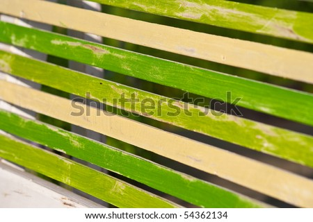 A part of wooden table in a garden.
