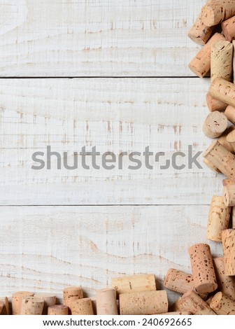 A partial cork frame on two sides of the image. High angle shot on a rustic whitewashed wood table, Suitable for wine lists with lots of copy space. - stock photo