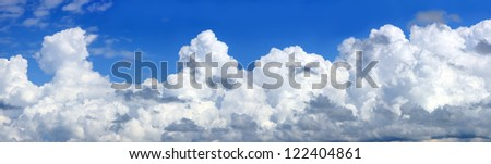 A partial panorama of a bank of cumulus clouds. - stock photo