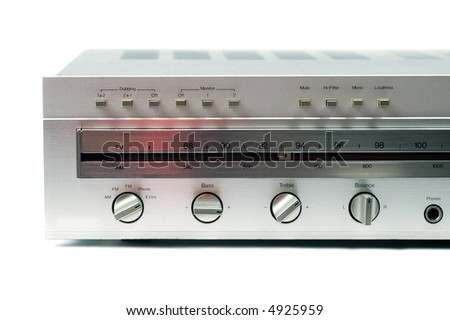 A partial view of a silver stereo hi-fi receiver from the 1970s against a white background. - stock photo