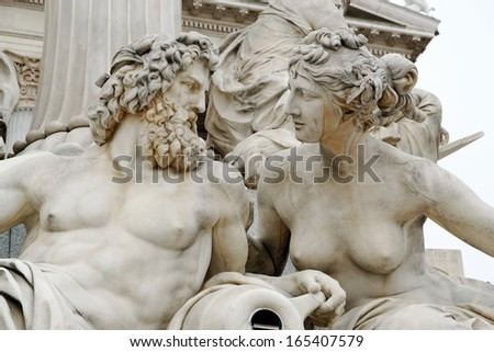 A particular of the Pallas Athena fountain, in front of the Austrian Parliament Building (Hohes Haus). The figures symbolize the rivers Danube, Inn, Elbe and Moldau. It was completed in 1902. - stock photo
