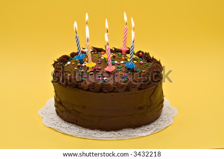 A party cake celebrating an anniversary or birthday. - stock photo