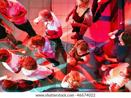 A party on the dance floor of a nightclub as viewed from above. - stock photo
