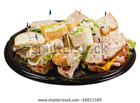 A party platter with wraps, bagels and sandwiches isolated on a white background.
