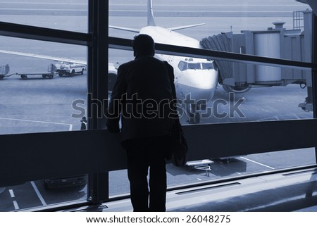 a passenger waiting for the flight at airport in shanghai china. - stock photo