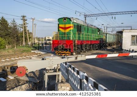 a passing train railroad crossing - stock photo