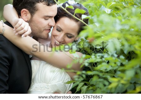 A passionate approaching between a just married couple - stock photo