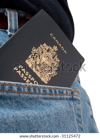A passport in a back pocket of someone wearing jeans, shot from behind, with back pocket visible, isolated on white.