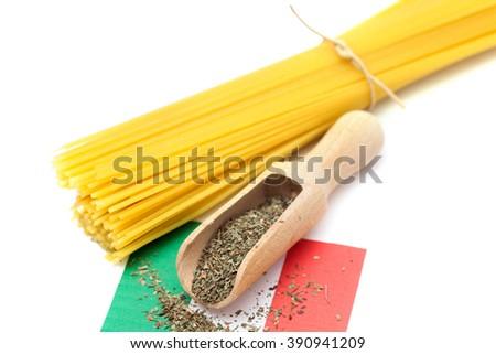 A pasta with seasoning on Italian flag - stock photo