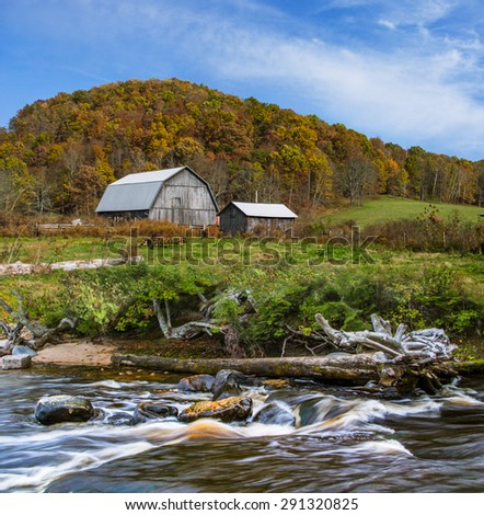 A Pastoral Landscape, Barn And River Below A Hill In Autumn, Central Ohio, USA - stock photo
