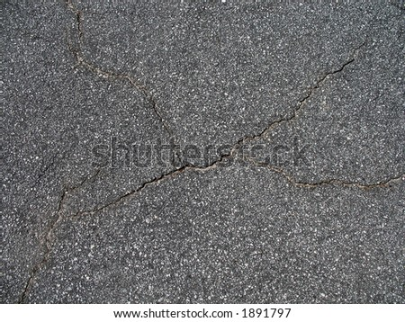 A patch of cracked asphault - stock photo