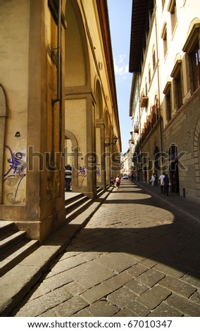 A path along a river in Florence - stock photo