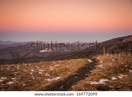 A path leads hikers along the Appalachian trail at Roan Mountain. this shot was taken after sunset in a brisk cold and windy day.  - stock photo