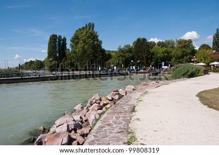 A path next to the landing stage of a ferryboat, Tihany, lake Balaton, Hungary - stock photo