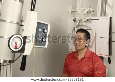 A patient getting his head x-rayed - stock photo