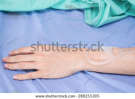 A patient in the hospital with saline intravenous, in Asian women hand - stock photo