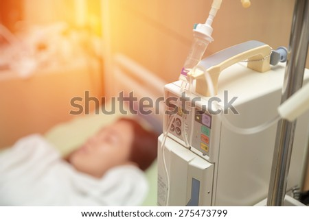 A patient in the hospital with saline intravenous (iv). Vintage filter. - stock photo