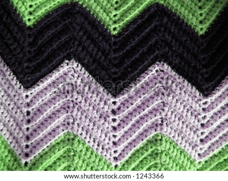 A patten of a cozy homemade afghan, just like grandma makes. - stock photo