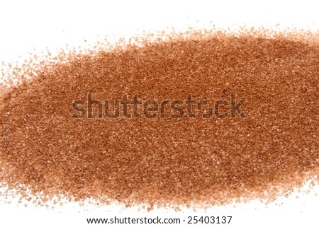 a pattern of sugar with cinnamon on white background