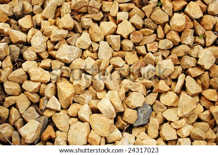 A pattern of yellow stones. - stock photo