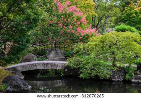 A peaceful Japanese garden and pond at Himeji Castle, Japan. - stock photo