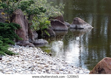A peaceful scene with glowing shore in a Japanese garden. - stock photo
