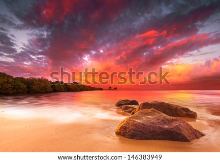 A Peaceful tropical scene at sunset - stock photo