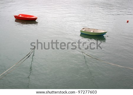 A peaceful waterscape witn two floating boats - stock photo