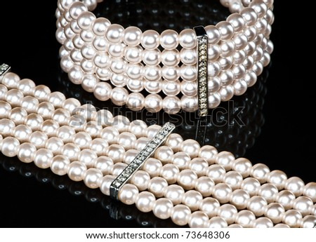 A pearl bracelet and a necklace (close-up) - stock photo
