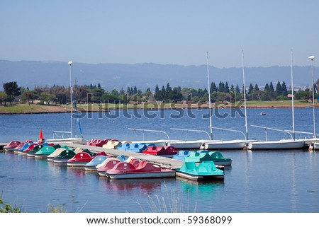 A pedalo is a form of waterborne transport, primarily for recreational use, powered through the use of pedals. - stock photo
