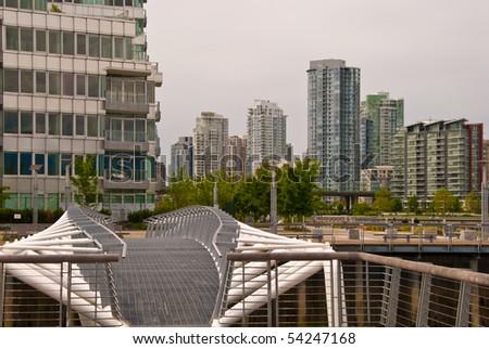 A pedestrian bridge at the False Creek Sea walk in Downtown of Vancouver. Canada. - stock photo