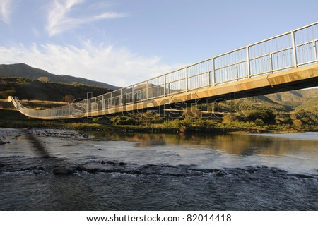 A pedestrian bridge over flood prone river in KZN South Africa