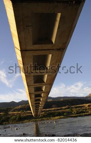A pedestrian bridge over flood prone river in KZN South Africa - stock photo