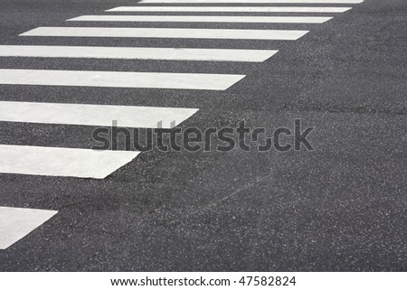 A pedestrian crossing in the city - stock photo