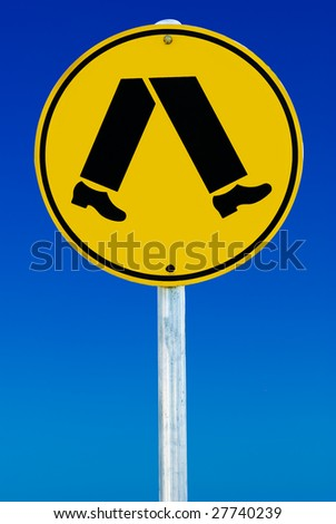 A pedestrian crossing sign consisting of a pair of legs in a circle isolated on a blue gradient sky. - stock photo