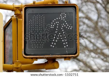 A Pedestrian crosswalk sign in New York City signals it's OK to cross - stock photo