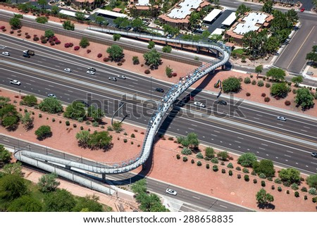 A pedestrian, cyclist bridge spanning the Loop 101 freeway in Chandler, Arizona - stock photo