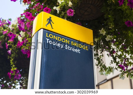 A pedestrian sign marking the location of London Bridge. - stock photo
