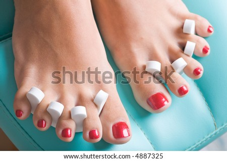 A pedicure process, focus on the left feet.