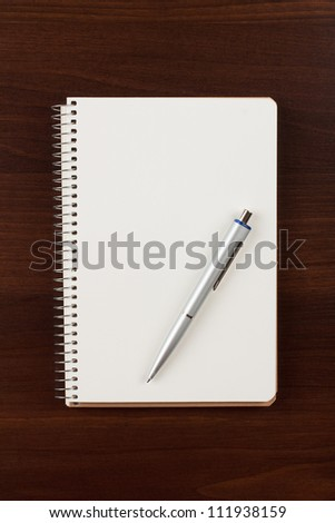 a pen and blank paper - stock photo