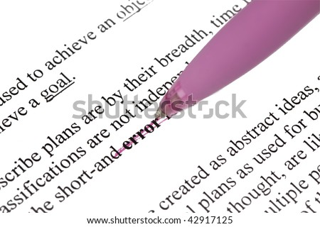A pen is being used for correcting error by using cross lines - stock photo