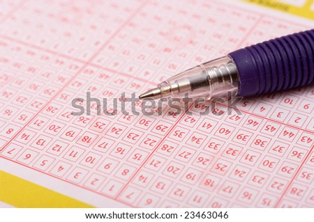 a pen is on a lottery ticket
