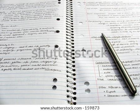 A pen on an open book - stock photo
