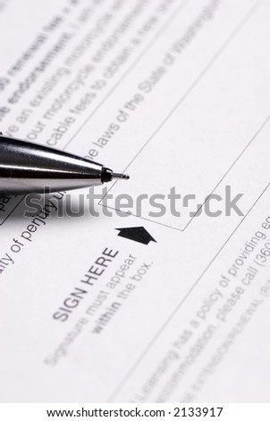 A pen sits ready to sign in the block