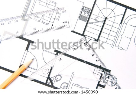 A pencil and geometric tools on top of a floor plan.