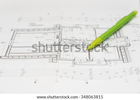 A pencil on an architecture design drawings - stock photo