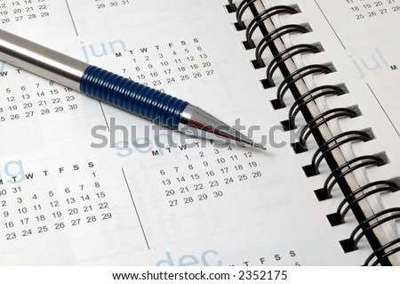A pencil on calender of a notebook. - stock photo