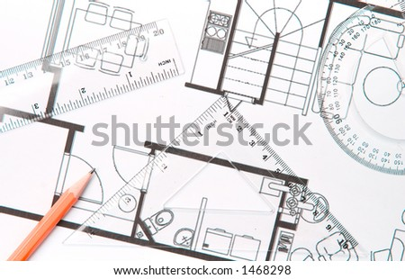 A pencil, setsquare and a protractor on top of building plan.