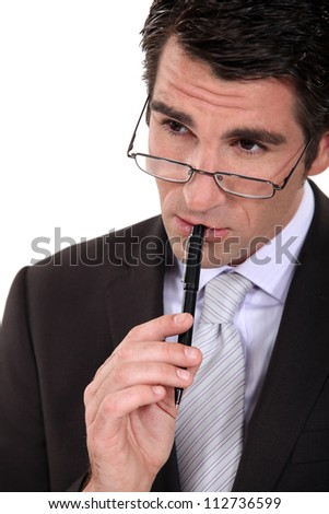 A pensive businessman. - stock photo